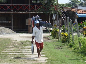 Fisherman with Outboard and Dinner