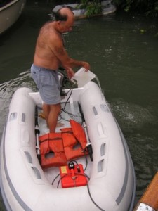 Gas Can Locked in Dinghy, David's Bailing a Tropical Downpour