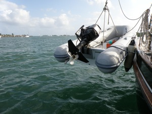 Hang the Dinghy - Look Carefully, You Can See the Cable Locking it to the Boat