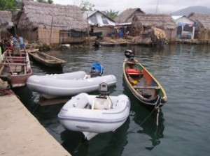 Dinghies VIsiting A San Blas Village