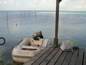 The Caribe Roll-Up Dinghy on trash duty in Cay Caulker, Belize
