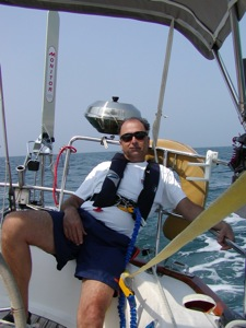 David in his Inflatable Life Vest and Tether as the Monitor Windvane Steers on an Overnight Passage