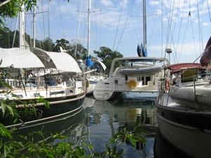 Winterlude - Dark Hull to Left, in Catamaran Marina, Rio Dulce