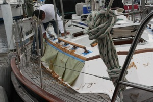 Hard at Work on Stripping the Eyebrow - Note the Protective Paper Taped on the Cabin Sides