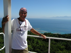 David's Bandana on top of the lighthouse in the Cayos Cochinos, Honduras - at least it covers his scalp!
