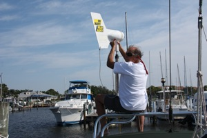 David, reinstalling our KISS wind generator ... which is as good as new & looking forward to cruising the Bahamas!