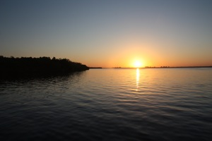 Sunrise over Ft Myers, the Ochechobee (sp?) Waterway - our mast is too high for the waterway, the fixed bridge is 48' and we're 55', so no go.
