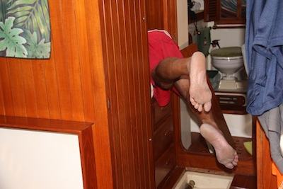 David, once again playing contortionist as he installs the Garmin 541S depthsounder below our pullman berth