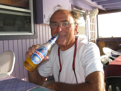 David enjoys his first Kalik (click)