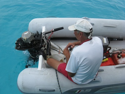 David working on our trusty Tohatsu in the Exumas.  Whew, close call!