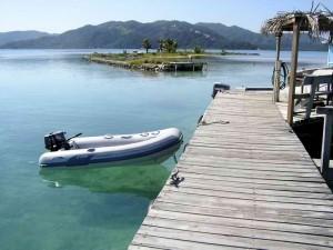 Dinghy enjoying Josh Caye off Guanaja, Bay Islands, Honduras.