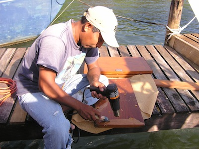 Arnulfo hard at work stripping our teak.  If you're at Catamaran and need teak work, we can highly recommend Arnulfo!