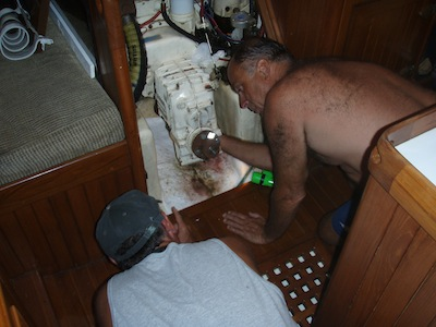 Doug helping David change the stuffing box IN the Rio Chagres, Panama... while Rayene & I stood by with emergency pumping assistance should the boys flood the boat.  Changing the packing in the water somehow seemed a marginally good idea...