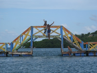 Local boys love to play on the colorful bridge connecting Providencia with Santa Catalina