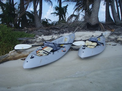 Our kayaks exploring the Green Islands, San Blas, Panama, you can see the fold down seats & paddles.  Ours come apart for easy storage in the quarterberth below.