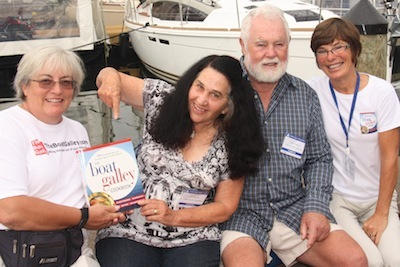 Lin & Larry Pardey help Carolyn (left) and Jan (right) kick off The Boat Galley Cookbook at the 2012 Annapolis Boat Show.