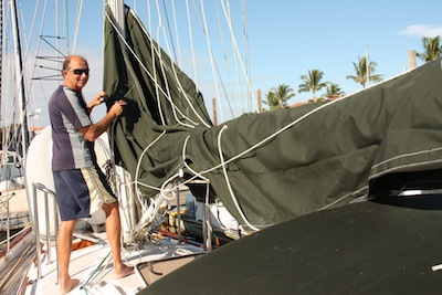 The Mackpack canvas & lines go on over the mainsail already on the boom.