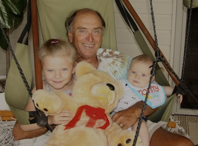 David relaxes at the lake cottage with granddaughter Gilly and grandson Dane