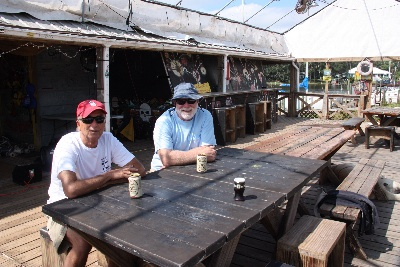 Exploring the Gulf Coast with our friend Doug, David & Doug share a cold libation at Pirate's Cove.