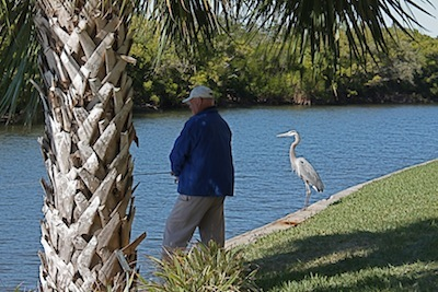 These two fishermen were busy attracting fish on the marina walk.