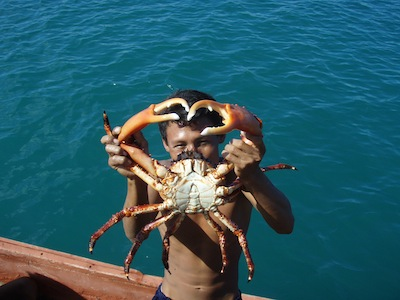 This young fisherman ran out of gas for his wooden cayuco and traded us this crab for a gallon of gas to get back to his village.