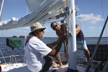 David and Peter figuring out the rigging the first time we put up the sails ... all three sails!