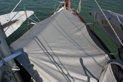 Our new bow cover - great for shade and rain.  We normally don't use it except for rain just because we like to keep the hammock on the bow when the weather is nice.  :)