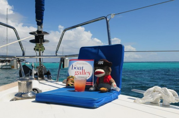 The Sock Monkey enjoying a rum punch while deciding what to make for dinner in the Tobago Cays.