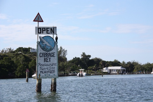 Sign welcoming boaters from the ICW in the Cabbage Key Marina/Restaurant channel.