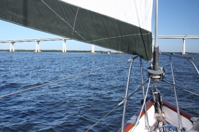 Sailing (maybe lugging?)under the Sanibel Bridge