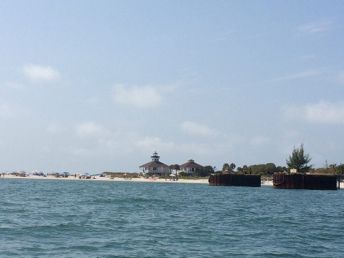 The lighthouse in the distance with the huge ships dock ruins.