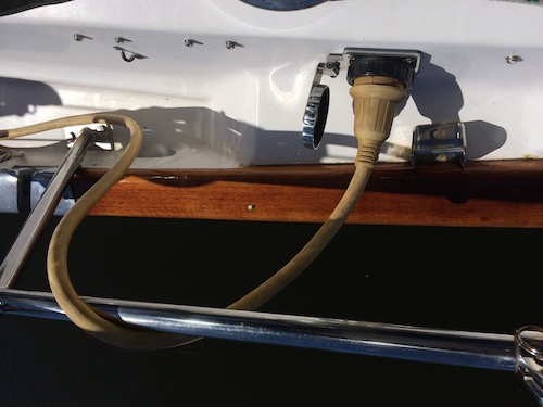 The cord wraps around the stainless lifeline extension by the boat end plug in to help take any tension off the plug.  Make sure the screw in part is securely screwed in.