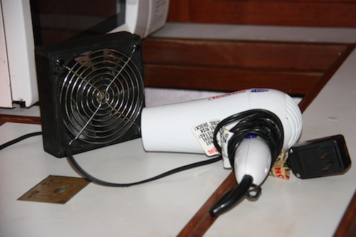 We use the hair dryer and fan to speed the defrosting process.