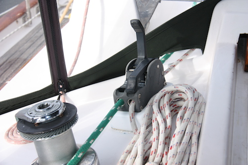 Halfway up the clutch will allow the line to come in but not slip back out accidentally lowering the dinghy.