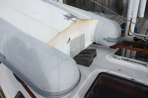 Another shot of how we use the kayak holders to keep the dinghy stern in place on the foredeck.
