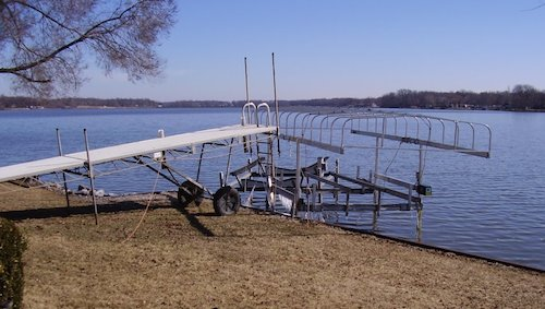 The sailboat lift and the skiboat lift are catiwampus against the dock.  Luckily the docks are out of the water in the front yard.