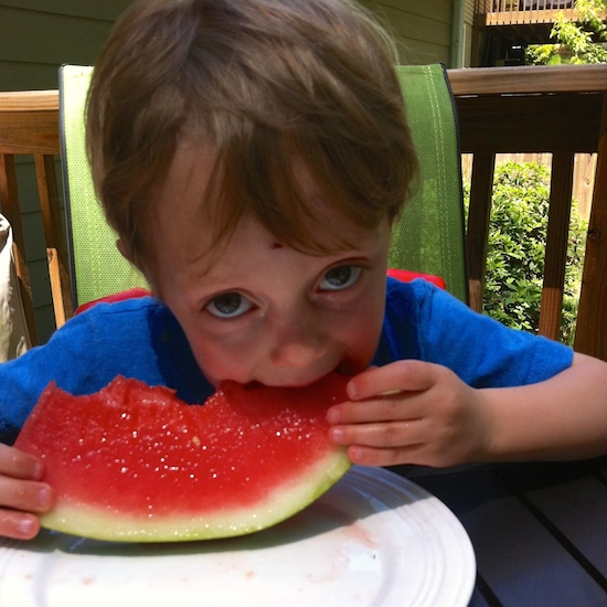 Rowan enjoys his summer watermelon.