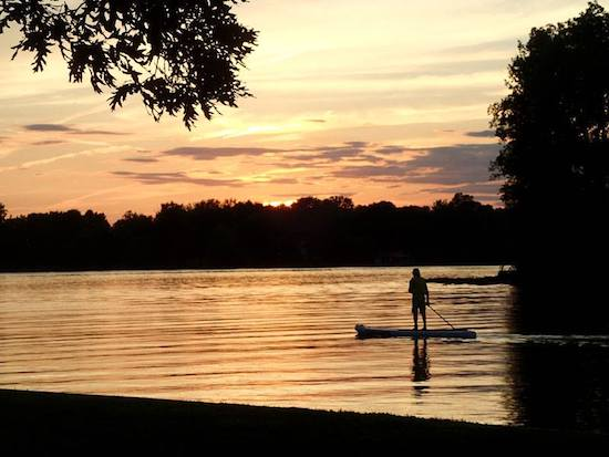 Carolyn's husband Dave enjoys sunset at the lake on the iSUP.
