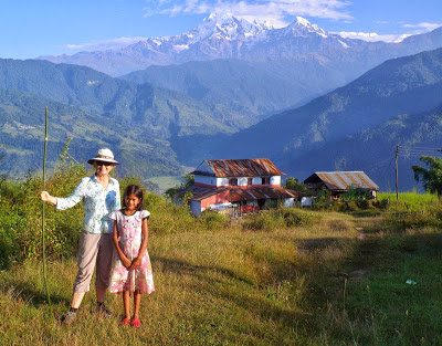 Former s/v Kristiana's Rayene with our guide Asuda outside of Pokhara, Nepal.  She lives in the house in the background. Check out the view from her house!
