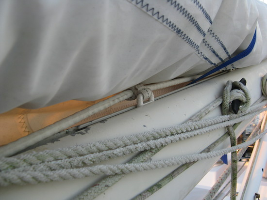 Mainsail boom slides in the boom ... secure but not totally up