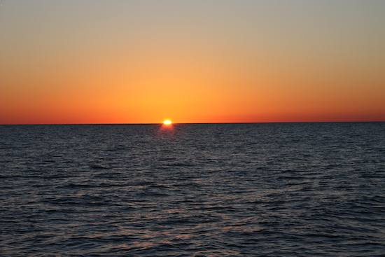 Why is it impossible to capture a green flash in a photo?  This one ranks right up there with the best we've seen...