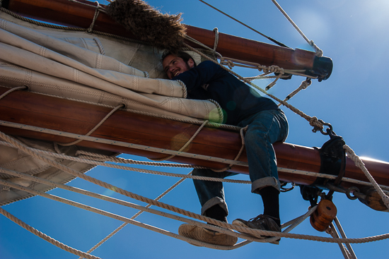 Securing a bit of the 8000 square feet of sail