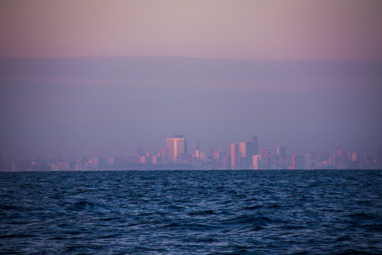 First glimpse of the Havana skyline through the early morning haze.