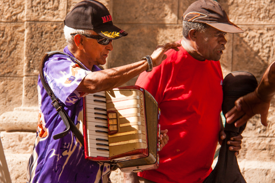 Accordion entertainer with his guitar buddy, Plaza de Armas, Old Town Havana.