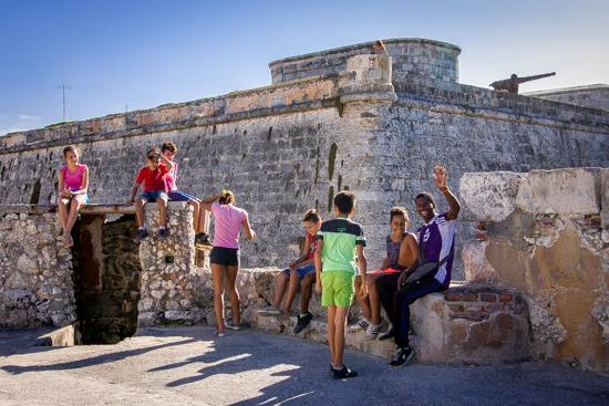 Kids exploring the catacombs of the fort at El Morro.