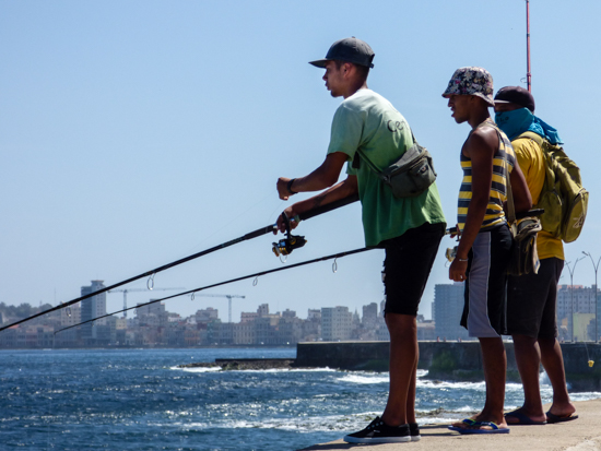 Boys enjoying the fishing atop the Malecon wall close to the US Embassy, downtown Havana.